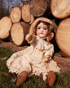antique doll and wood pile