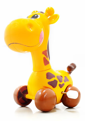 yellow mechanical giraffe with wind-up feature