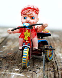 tin toy tricycle with plastic rider