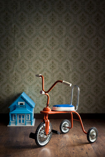 collectible tricycle and dollhouse